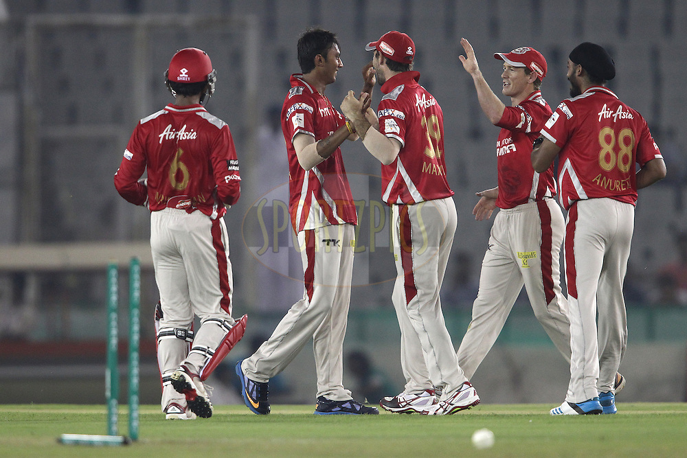 Akshar Patel of the Kings XI Punjab is congratulated by Glenn Maxwell of the Kings XI Punjab for getting Hobart Hurricanes captain Tim Pain wicket during match 2 of the Oppo Champions League Twenty20 between the Kings XI Punjab and the Hobart Hurricanes held at the Punjab Cricket Association Stadium, Mohali, India on the 18th September 2014<br /> <br /> Photo by:  Shaun Roy / Sportzpics/ CLT20<br /> <br /> <br /> Image use is subject to the terms and conditions as laid out by the BCCI/ CLT20.  The terms and conditions can be downloaded here:<br /> <br /> http://sportzpics.photoshelter.com/gallery/CLT20-Image-Terms-and-Conditions-2014/G0000IfNJn535VPU/C0000QhhKadWcjYs