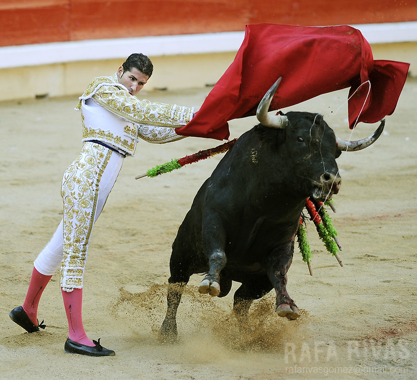 Spanish matador Serafin Martin gives a pass with muleta to his Conde de la Corte fighting bull during the first corrida of the San Fermin festivities, on July 7, 2008, in Pamplona, northern Spain.