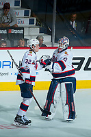 REGINA, SK - MAY 20: Robbie Holmes #32 celebrates a goal with Max Paddock #33 of Regina Pats against the Acadie-Bathurst Titan at the Brandt Centre on May 20, 2018 in Regina, Canada. (Photo by Marissa Baecker/CHL Images)