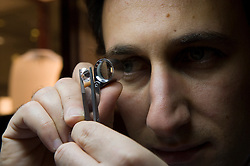 Arko Tourbendian, uses a loop to inspect a 5.9 karat diamond, at the Diamond Land store in Antwerp, Belgium, on Thursday, Oct. 22, 2009. (Photo © Jock Fistick)