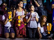 30 SEPTEMBER 2017 - BANGKOK, THAILAND: People wait for the chariot carrying the deity during the Navratri parade in Bangkok. Navratri is a nine night (10 day) long Hindu celebration that marks the end of the monsoon and honors of the divine feminine Devi (Durga). The festival is celebrated differently in different parts of India, but the common theme is the battle and victory of Good over Evil based on a regionally famous epic or legend such as the Ramayana or the Devi Mahatmya. Navratri is celebrated throughout Southeast Asia in communities that have large Hindu population. Bangkok's celebration of Navratri was subdued this year because Thais are still mourning the death of Bhumibol Adulyadej, the Late King of Thailand, who died on October 13, 2016.      PHOTO BY JACK KURTZ
