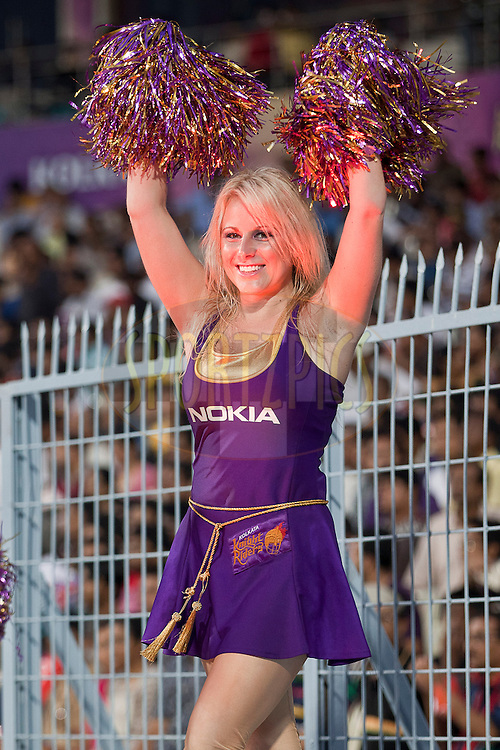 KKR chear girl during match 24 of the Indian Premier League ( IPL ) between the Kolkata Knight Riders and the Royal Challengers Bangalore held at Eden Gardens Cricket Stadium in Kolkata, India on the 22nd April 2011..Photo by Saikat das/BCCI/SPORTZPICS