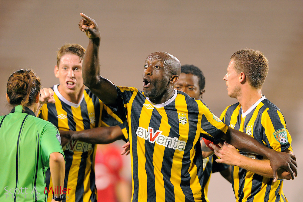 Charleston Battery defender John Wilson (25) argues a call with the referee during Orlando City Lions 4-0 win over the Battery at the Florida Citrus Bowl on July 27, 2012 in Orlando, Florida. The win clinched the USL-Pro regualr season title for Orlando...© 2012 Scott A. Miller..