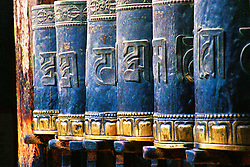 China, Xiahe, 2005. The right hands of the truly devout are often calloused from the effort of keeping prayer wheels constantly turning clockwise..