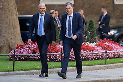 © Licensed to London News Pictures. 25/07/2019. London, UK. Chancellor of the Exchequer Sajid Javid and Northern Ireland Secretary Julian Smith arrive in Downing Street for the first meeting of the new Cabinet. Later today Prime Minister Boris Johnson will speak in the House of Commons.  Photo credit: George Cracknell Wright/LNP