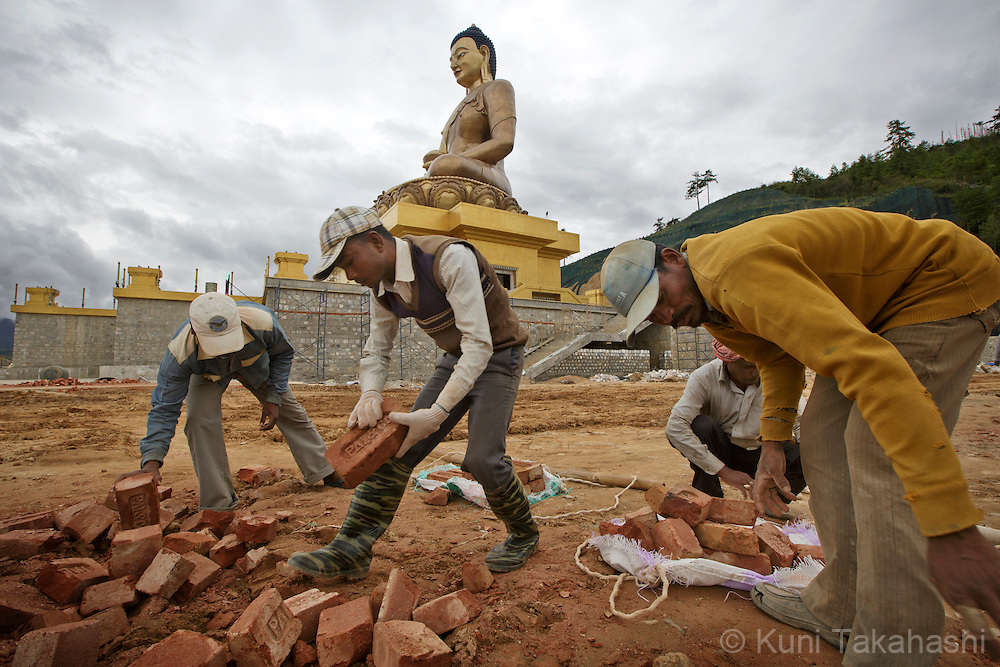 Indian migrant labors work at the site of the Golden Buddha in Thimphu, Bhutan on September 1, 2013. Bhutanese economy heavily relies on Indian labors, mostly from West Bengal. <br /> (Photo by Kuni Takahashi)
