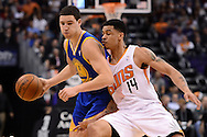 Dec 15, 2013; Phoenix, AZ, USA; Golden State Warriors guard Klay Thompson (11) handles the ball against defender Phoenix Suns guard Gerald Green (14) in the first half at US Airways Center. Mandatory Credit: Jennifer Stewart-USA TODAY Sports