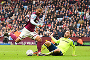 Aston Villa striker Lewis Grabban (45) battles with Derby County defender Richard Keogh (6) during the EFL Sky Bet Championship match between Aston Villa and Derby County at Villa Park, Birmingham, England on 28 April 2018. Picture by Jon Hobley.