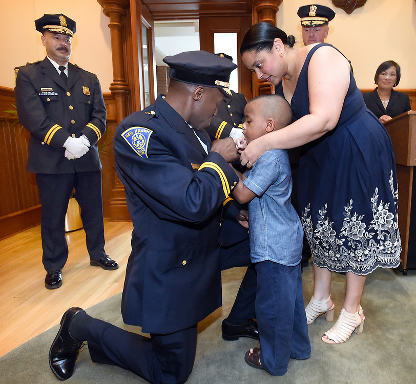 (Mara Lavitt &mdash; New Haven Register) <br /> July 1, 2014 New Haven<br /> A ceremony was held at New Haven City Hall to swear in two new New Haven assistant chiefs of police: Al Vazquez and Anthony Campbell, shown here getting his badge pinned on by son Paxon age 5 and wife Stephanie.<br /> mlavitt@newhavenregister.com