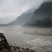 David Morton gazes at the Bhagirathi (Ganges) River as it flows through early morning fog above Uttarkashi, Uttarakhand, India.