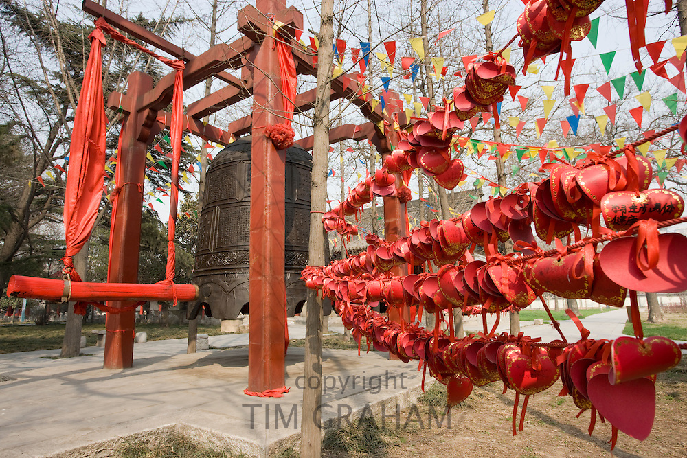Prayers wishes and greetings tied by the Buddhist morning prayer bell, Small Wild Goose Pagoda, Xian, China