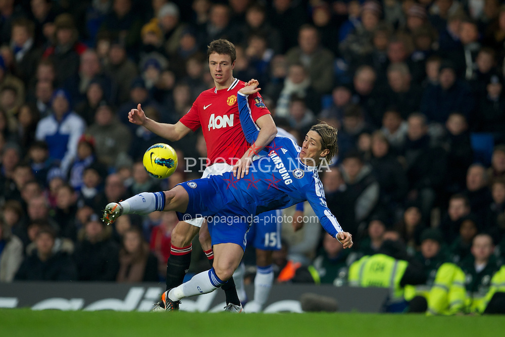 LONDON, ENGLAND - Sunday, February 5, 2012: Chelsea's Fernando Torres in action against Manchester United's Jonny Evans during the Premiership match at Stamford Bridge. (Pic by David Rawcliffe/Propaganda)
