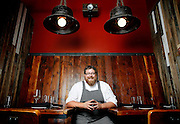 SHOT 8/15/13 4:36:55 PM - Justin Brunson, Owner and Executive Chef at Old Major poses for a portrait in the bar at the restaurant in Denver, Co. The restaurant focuses on heritage-raised meats from Colorado farms, features an in-house butchery program and bills itself as contemporary farmhouse cuisine. (Photo by Marc Piscotty / © 2013)