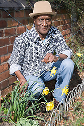 Older man gardening,