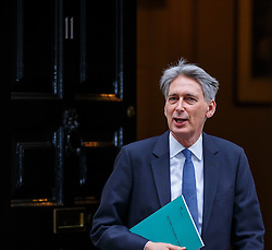 © Licensed to London News Pictures. 23/11/2016. London, UK. Chancellor of Exchequer PHILIP HAMMOND leaves Downing Street before the autumn statement announcement on Wednesday, 23 November 2016. Photo credit: Tolga Akmen/LNP