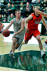 BLOOMINGTON, IL - December 15: Grant Wolfe and Tyler Ingebrigtsen during a college basketball game between the IWU Titans  and the Carroll Pioneers on December 15 2018 at Shirk Center in Bloomington, IL. (Photo by Alan Look)