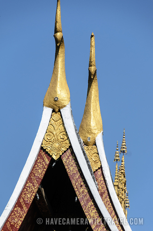 Chofah on the roof of Wat Xieng Thong (Temple of the Golden City) on the northern tip of the peninsula of Luang Prabang, Laos. Originally built around 1560, the temple was the main site for royal coronations and remains ones of the most important temples in Laos.