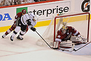 May 13, 2012; Glendale, AZ, USA; Phoenix Coyotes goalie Mike Smith (41) blocks the shot from Los Angeles Kings center Mike Richards (10) in the first period of game one of the Western Conference finals of the 2012 Stanley Cup Playoffs at Jobing.com Arena.  Mandatory Credit: Jennifer Stewart-US PRESSWIRE.