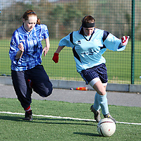 Maeve McKweon of St. Annes Killaloe keeps the pressure on St. Caimins Tony Lagan during the girls soccer blitz in Lees Road on Thursday.<br /><br />Photograph by Yvonne Vaughan.