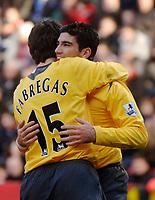 Photo: Glyn Thomas.<br />Charlton Athletic v Arsenal. The Barclays Premiership.<br />26/12/2005.<br /> Arsenal's Jose Antonio Reyes (R) celebrates with Francesc Fabregas (L) after scoring a goal.