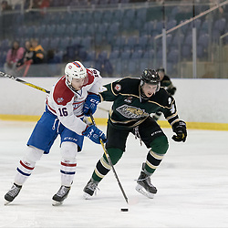KINGSTON, ON - MAR 9,  2017: Ontario Junior Hockey League, playoff game between the Cobourg Cougars and Kingston Voyageurs, Austin Grzenia #16 of the Kingston Voyageurs skates with the puck while being pursued by Matthew Bumstead #4 of the Cobourg Cougars during the 3rd period.<br /> (Photo by Ian Dixon/ OJHL Images)