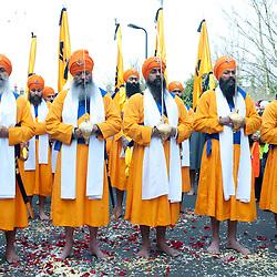 London, UK - 7 April 2013: Panj Piares hold swords and pray during the Nagar Kirtan celebrations