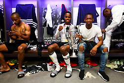 Free to use courtesy of Sky Bet. Ryan Sessegnon looks on as Fulham celebrate in the dressing room after winning the game 0-1 to win the Sky Bet Championship Play-Off Final and secure Promotion to the Premier League - Rogan/JMP - 26/05/2018 - FOOTBALL - Wembley Stadium - London, England - Aston Villa v Fulham - Sky Bet Championship Play-Off Final.