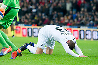 Football - 2016 / 2017 Premier League - Swansea City vs. Arsenal<br /> <br /> Gylfi Sigurdsson of Swansea falls to his knees after failing to connect with a cross in the goalmouth, at the Liberty Stadium.<br /> <br /> COLORSPORT/WINSTON BYNORTH