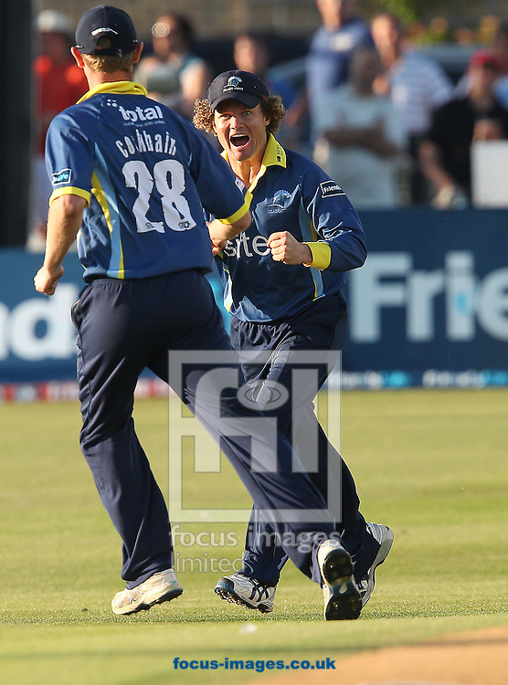 Picture by Paul Terry/Focus Images Ltd. 07545 642257.24/07/12.Hamish Marshall ( R ) of Gloucestershire Gladiators takes a catch to take the wicket of Chris Nash of Sussex Sharks during the Friends Life T20 Quarter Final match at the PROBIZ County ground, Hove.