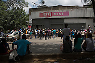 2016/05/26 - Caracas, Venezuela: People queue in front of Mini Central Madeirense Super Market in La Urbina neighbourhood in Caracas. (Eduardo Leal)