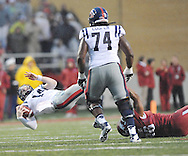Ole Miss Rebels quarterback Bo Wallace (14) is tackled by Arkansas Razorbacks defensive end Trey Flowers (86) as Ole Miss Rebels offensive lineman Fahn Cooper (74) looks on at Donald W. Reynolds Razorback Stadium in Fayetteville, Ark. on Saturday, November 22, 2014. Arkansas won 30-0.