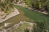 Confluence of the muddy Cimarron River entering the Gunnison River.  Black Canyon Of The Gunnison.  Colorado.