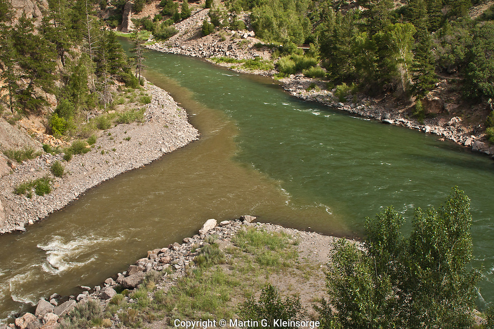 Confluence of the muddy Cimarron River entering the Gunnison River.  Black Canyon Of The Gunnison.  Colorado.