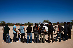 A group of migrants are searched by Mexican Police as they head from Altar to the border to cross into the US.  Altar is the starting point for many migrants' journeys to the US. In Altar they find guides and coyotes to take them across the border.  The town's economy is nearly entirely dependent on the migrants. Recently drug cartels have become involced in the smuggling of people, using the same routes as the drugs and charging the migrants an exit tax to leave the country.