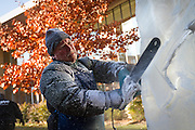 Ice sculptor Bill Gordish gets sprayed by ice shavings while carving an axe into a 8' tall beverage luge during the Festival of Ice at the JRC on Wednesday afternoon. Gordish, a professional based out of Des Moines, Iowa, has been creating frosty works of art for over 25 years.