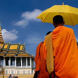 Novice monks walk passed the Royal Palace in Cambodia's capital city of Phnom Penh.