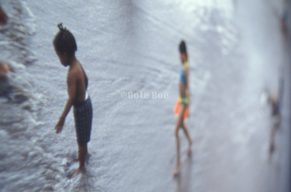 Distorted view of children playing in the water