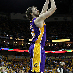 April 22, 2011; New Orleans, LA, USA; Los Angeles Lakers power forward Pau Gasol (16) shoots against the New Orleans Hornets during the second half in game three of the first round of the 2011 NBA playoffs at the New Orleans Arena. The Lakers defeated the Hornets 100-86.   Mandatory Credit: Derick E. Hingle