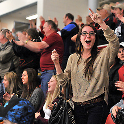 """122FORT FRANCES, ON - May 1, 2015 : Central Canadian Junior """"A"""" Championship, game action between the Fort Frances Lakers and the Toronto Patriots, semi-final game of the Dudley Hewitt Cup.  A Fort Frances Lakers fan celebrates.<br /> (Photo by Clint Bruyere / OJHL Images)"""