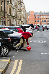 Pictured: Labour activists retreives a run away balloon<br /> <br /> Scottish Labour leader, Kezia Dugdale began her Party's Holyrood election campaign by joining supporters at a street stall in Morningside in Edinburgh today. She was joned by local candidate Daniel Johnston<br /> <br />  Ger Harley | EEm 23 March 2016