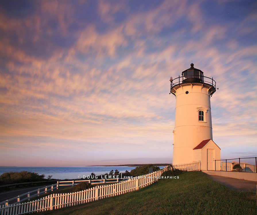 The Nobska Point Lighthouse Tower Bathed In Early Morning Sunlight, Woods Hole, Cape Cod, Massachusetts. USA
