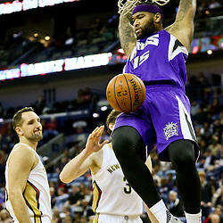 Jan 28, 2016; New Orleans, LA, USA; Sacramento Kings center DeMarcus Cousins (15) dunks over New Orleans Pelicans forward Ryan Anderson (33)  during the first quarter of a game at the Smoothie King Center. Mandatory Credit: Derick E. Hingle-USA TODAY Sports