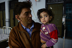 November 20, 2016 - Pukhrayan, Kanpur, India - Dhawal, aged 40, surviver of Train accident, holds his 2 years old daughter  , admitted with her sister in district hospital, some 60 kms from Kanpur, on November 20,2016. Indore Patna express train derailed on sunday's early morning. more than 200 people died and several injured, according to officials. (Credit Image: © Ritesh Shukla/NurPhoto via ZUMA Press)