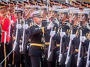 23 JULY 2015 - BANGKOK, THAILAND:  Thai military officers check out Thai soldiers and sailors before the arrival ceremony for the Vietnamese Prime Minister at Government House in Bangkok. The Vietnamese Prime Minister and his wife came to Bangkok for the 3rd Thailand - Vietnam Joint Cabinet Retreat. The Thai and Vietnamese Prime Minister discussed issues of mutual interest.     PHOTO BY JACK KURTZ
