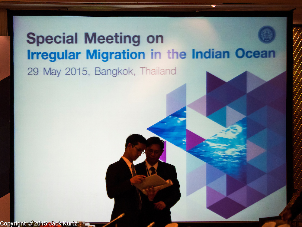 "29 MAY 2015 - BANGKOK, THAILAND:  Delegates talk in front of the video screen before the opening of  the ""Special Meeting on Irregular Migration in the Indian Ocean."" Thailand organized and hosted the meeting at the Anantara Siam Hotel in Bangkok. The meeting brought together representatives from the 5 countries impacted by the boat people exodus: Thailand, Malaysia and Indonesia, which have all received boat people, and Myanmar (Burma) and Bangladesh, where they are coming from. Non-governmental organizations, like the International Organization for Migration (IOM) and UN High Commissioner for Refugees (UNHCR) as well as countries responding to the crisis, like the United States, also attended the meeting. A total of 22 organizations attended the one day conference.     PHOTO BY JACK KURTZ"