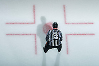 KELOWNA, BC - DECEMBER 27: Line official Cody Waner prepares to drop the puck during third period at the Kelowna Rockets against the Kamloops Blazersat Prospera Place on December 27, 2019 in Kelowna, Canada. (Photo by Marissa Baecker/Shoot the Breeze)