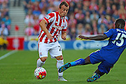 Stoke City's Xherdan Shaqiri rides a challenge from Leicester City's Jeff Schlupp during the Barclays Premier League match between Stoke City and Leicester City at the Britannia Stadium, Stoke-on-Trent, England on 19 September 2015. Photo by Aaron Lupton.