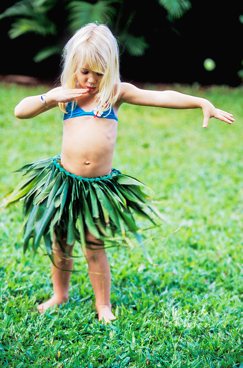 Hawaii, USA --- Girl Dancing Wearing Grass Skirt