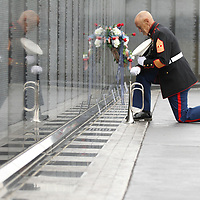 USMC Ret. Master Gunnery Sergeant Bob Verrell takes to moment to honor those at the repelcia Vietnam Memorial Wall following its opening ceremonies in Tupelo on Thursday.