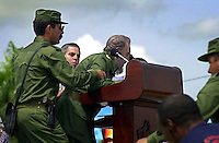 Cuban President Fidel Castro falls during a speach in Havana, Cuba on June 23, 2001. (Photo/Cristobal Herrera)....